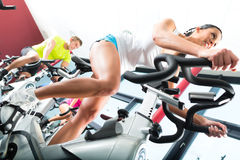 Young People Spinning in the fitness gym stock images