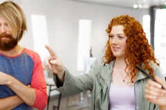 Young people standing in a gallery and contemplating artwork. Young people standing in a gallery and contemplating abstract artwork Royalty Free Stock Photos