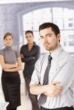 Young people standing in office arms crossed Royalty Free Stock Image