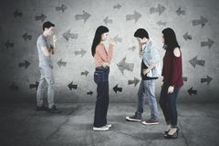 Young people stands with confused expression stock images