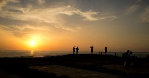 Young people staring at sunset Stock Photo