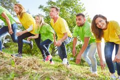Young people start a race. At a team building event in the summer royalty free stock photo
