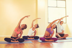 Young People Stretching in Yoga Class Stock Photography