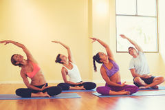 Young People Stretching in Yoga Class Royalty Free Stock Images