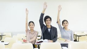 Young people student push hand up in the indoor classroom royalty free stock photos