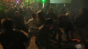 Young people students dancing at party with singing group at the stage stock footage
