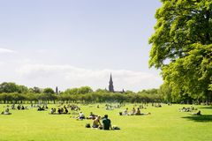 Young people, students of Edinburgh University enjoy a sunny day. Young people, students of Edinburgh University enjoying a sunny day in the Meadows, Edinburgh royalty free stock photo