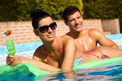 Young people at summer in pool smiling royalty free stock image