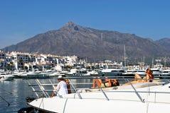 Young people sunbathing on yacht, Spain. Stock Photo