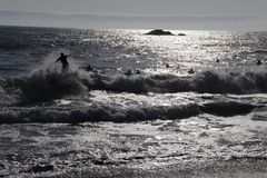Men surfing on the beach of Reñaca, Chile stock photos