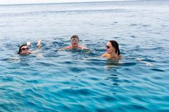 Young people swimming in the sea royalty free stock photo