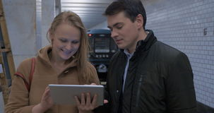 Young people with tablet computer in subway stock video footage