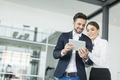 Young people with tablet in the office Stock Image
