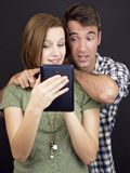 Young people with tablet Royalty Free Stock Images