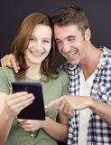 Young people with tablet Stock Images