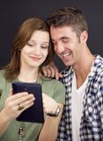 Young people with tablet Royalty Free Stock Photos