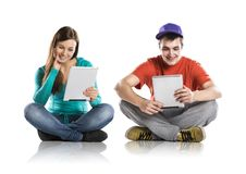 Young people with tablets Stock Photography