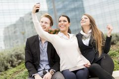 Young people taking photo with mobile phone Stock Photos