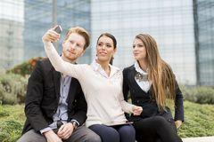 Young people taking photo with mobile phone Royalty Free Stock Photo