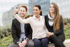 Young people taking photo with mobile phone Royalty Free Stock Photography