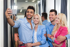 Young People Taking Selfie Photo Fitting Room Fashion Shop, Happy Smiling Couples Customers Stock Photography