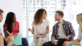 Young people talking together stock footage