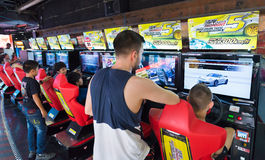 Young people and teenagers play in amusement arcade, Bangkok, Th Royalty Free Stock Photography