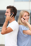 Young people and telephony Stock Photography