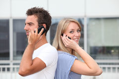 Young people and telephony Royalty Free Stock Photo