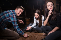 Young people thinking and moving parts of a conundrum to get out. Of the trap, escape the room game concept Stock Images