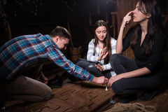 Young people thinking, moving parts of a conundrum and trying to. Get out of the trap, escape the room game concept Stock Photos