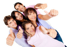 Young people with thumbs-up Royalty Free Stock Photography