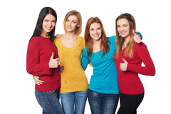 Young people with thumbs up Royalty Free Stock Photo
