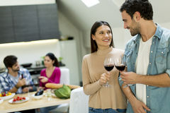 Young people toasting. Young couple toasting with glasses of red wine Stock Photos