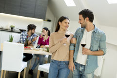Young people toasting. Young couple toasting with glasses of red wine Stock Images