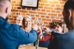 Young people toasting and laughing. Royalty Free Stock Photos