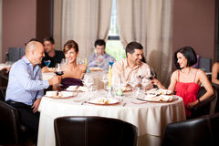 Young people toasting restaurant table Stock Image