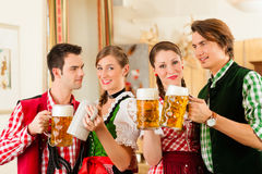 Young people in traditional Bavarian Tracht Royalty Free Stock Photography