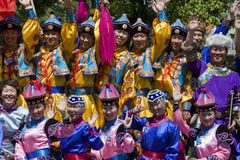 Young people in traditional ethnic clothing. BANJA LUKA - JUNE 21 - Young people in traditional Chinese ethnic clothing on International folk dance festival Stock Photography