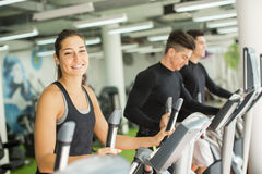 Young people training in the gym Royalty Free Stock Photos