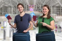 Young people travel traveling with luggage baggage airport bag f. Lying vacation holidays fly Stock Photography