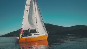 Young people traveling on a small sailing boat.  stock video