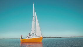 Young people traveling on a small sailing boat stock video footage