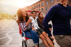 Young people traveling on tricycle Royalty Free Stock Photos