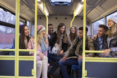 Young people travelling by bus together. stock images
