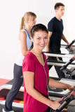 Young people on treadmill running exercise Stock Image