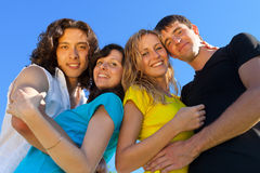 Young people, two girls and two. Boys, hugged each other and smile Stock Photos