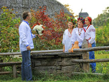 Young people in Ukrainian style clothing. Flirting outdoors Stock Photos