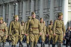 Young people in the  uniform of the Second World War. Royalty Free Stock Photo