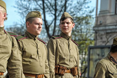 Young people in the  uniform of the Second World War. Royalty Free Stock Image